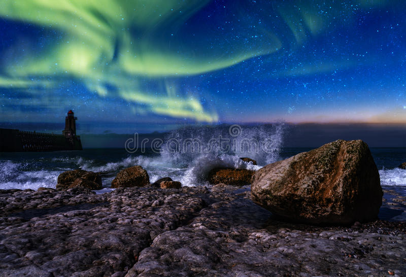Northern lights. Beautiful northern light at the rock beach night sky and low tide