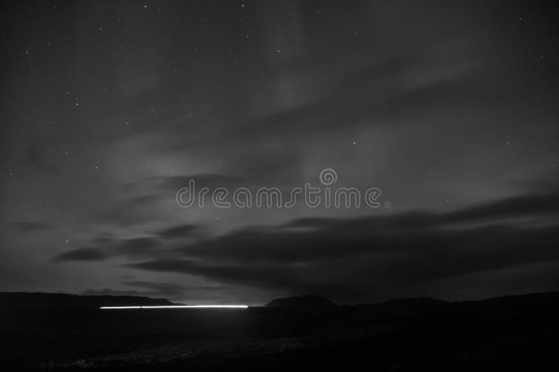 Northern light black sky with stars. Nature miracles. Aurora dark sky. Amazing nature phenomena. Best place see aurora. Borealis. When is best time to see royalty free stock photography
