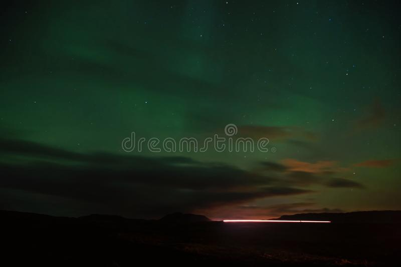 Northern light black sky with stars. Nature miracles. Aurora dark sky. Amazing nature phenomena. Best place see aurora. Borealis. When is best time to see royalty free stock images