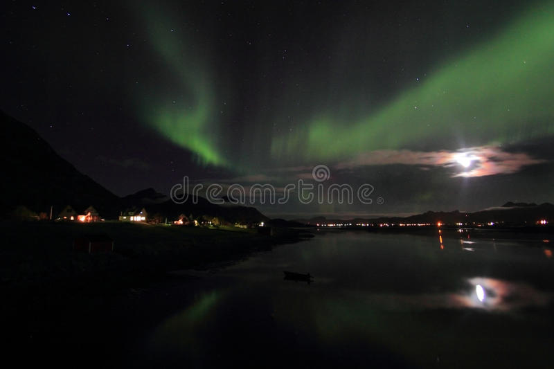 Northern Light mirroring in a Lofoten's fjord stock image