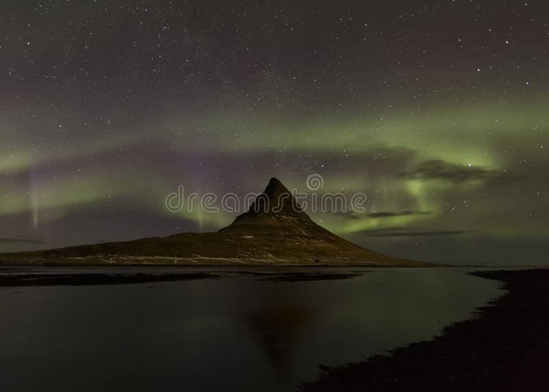 Northern Lights over Mt. Kirkjufell, Iceland stock images