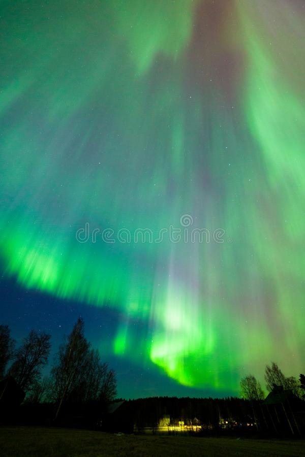 Northern lights aurora borealis landscape. In Finland stock photography