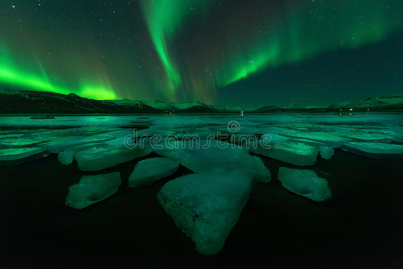 Northern lights aurora borealis in the night sky. stock images