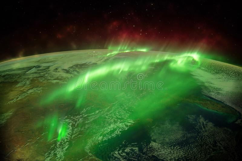 Northern lights aurora borealis over planet Earth `Elements of this image furnished by NASA` close up stock photo