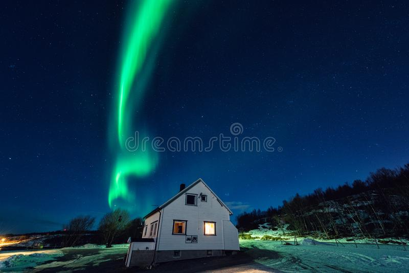 Northern lights aurora borealis over tourist camping in Lofoten islands, Norway. Night winter landscape stock images