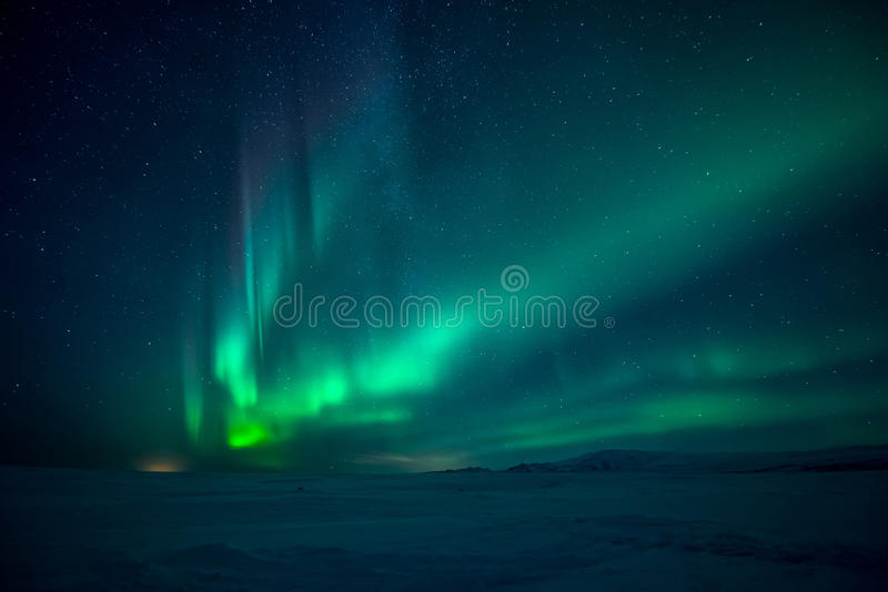 Northern Lights aurora borealis. And stars over mountains stock photo