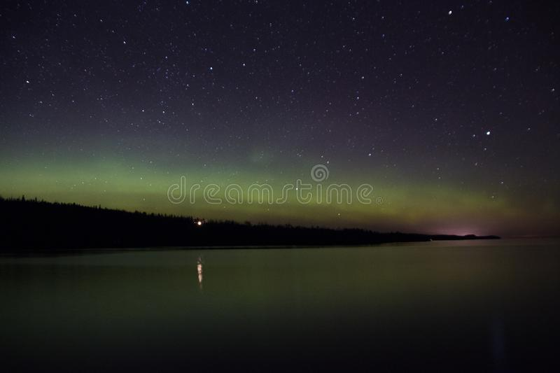 Northern lights and Aurora over Lake Superior on the North Shore of Lake Superior in Minnesota.  stock images