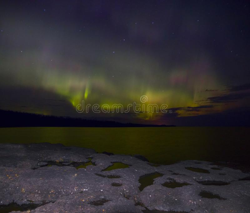 Northern Lights dance above the North Shore of Lake Superior in Minnesota.  stock photos