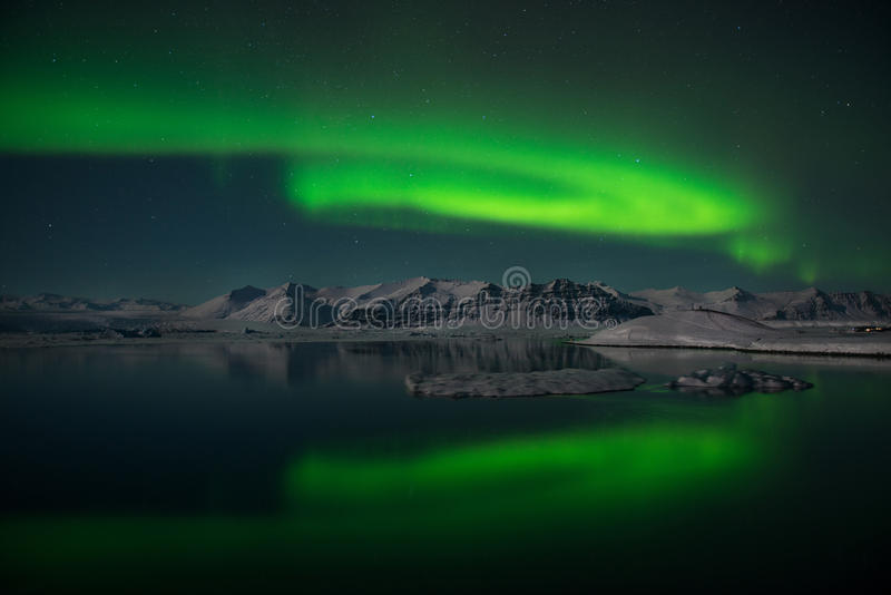 The Northern Lights dance over the glacier lagoon Jokulsarlon, Iceland royalty free stock photos