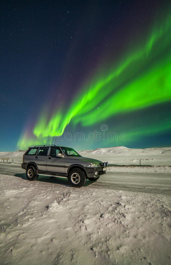 Northern Lights. And a Jeep during winter time in Iceland stock photos