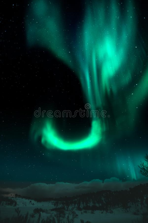Northern lights making shapes on Nordic sky royalty free stock photo