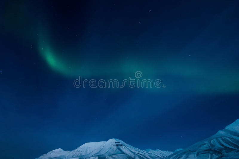 The Northern lights in the mountains of Svalbard, Longyearbyen, Spitsbergen, Norway wallpaper royalty free stock images