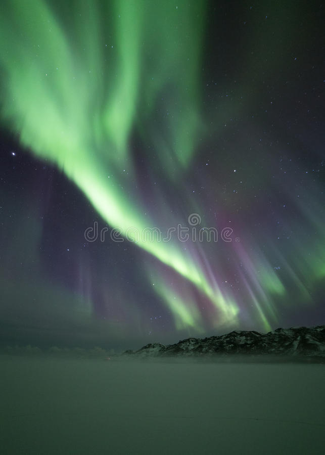 Northern lights over mountain royalty free stock image