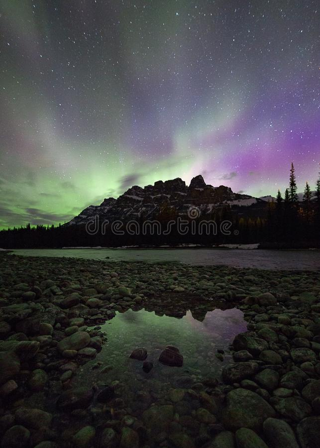 Northern lights over a mountain in Banff National Park in Canada stock image