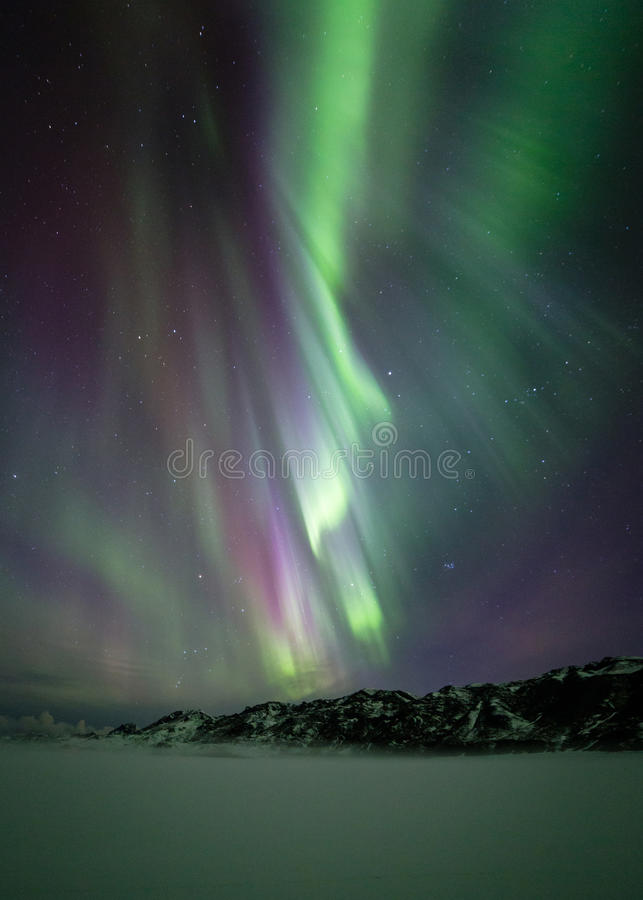 Northern lights over mountain royalty free stock images