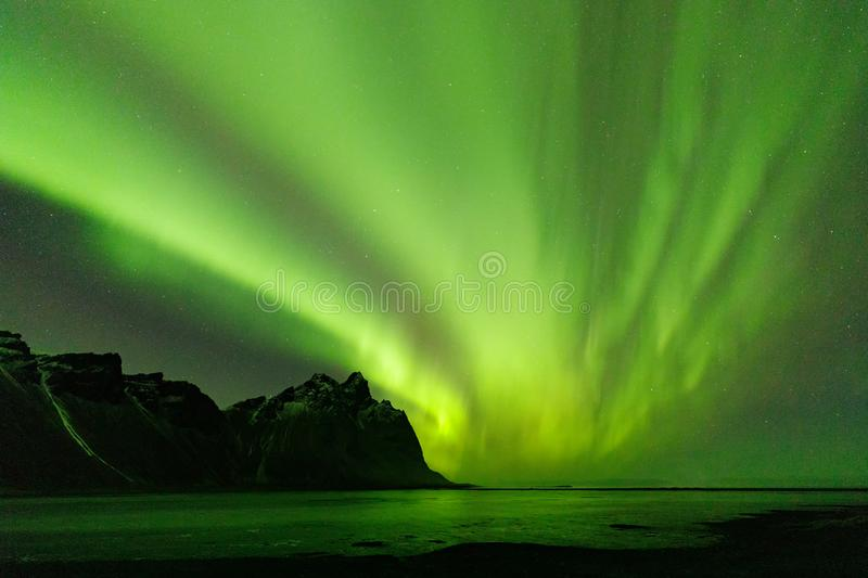 Iceland Northern Lights over Vestrahorn Mountain at Stokksnes peninsula in Southeast Iceland. Northern Lights over Vestrahorn Mountain at Stokksnes peninsula in royalty free stock photo