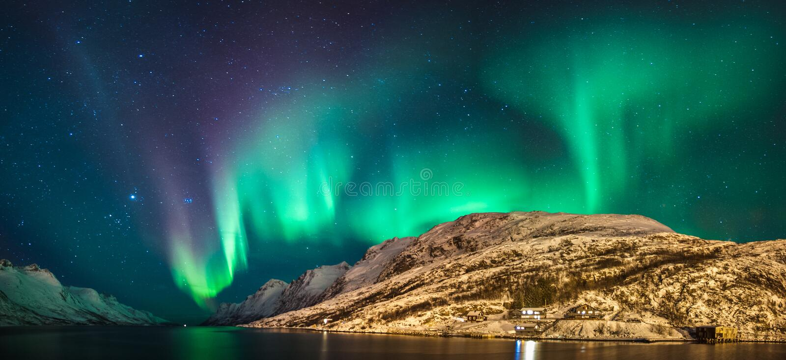 Northern lights. Panorama of northern lights over Ersfjordbotn,Tromso-Norway