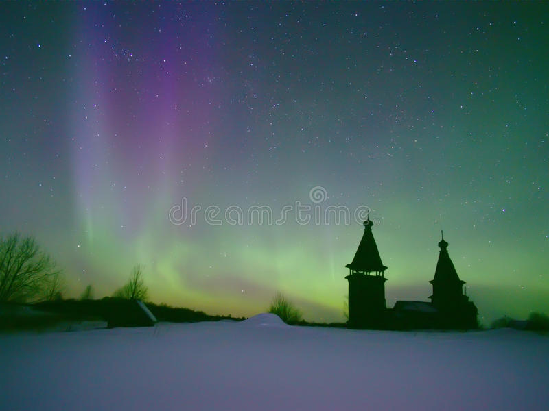 Northern lights. Purple-green northern lights over church sacred Barbaria in village Jandomozero. Karelia, Russia. March 29, 2013 stock image