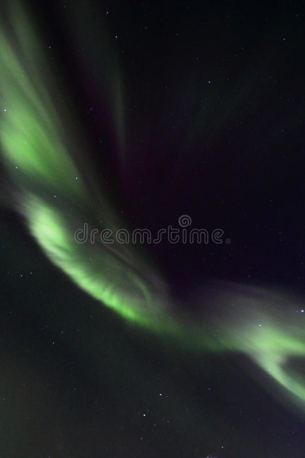 Northern Lights ribbon over Gimsoey. Northern Light mirroring in the fjord facing Gimsoey, Lofoten islands stock photos