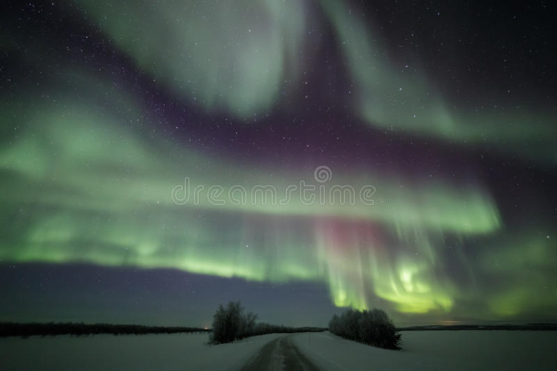 Northern lights road in Finnish Lapland stock photo