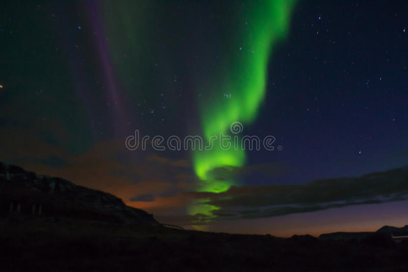 Northern lights with a sanke shape stock photo