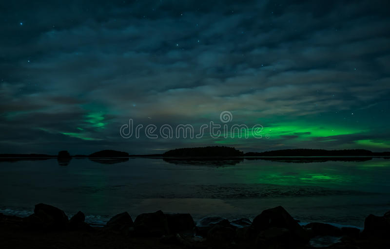 Northern lights. Scenic view of a lake landscape with northern lights and moonlight Aurora borealis stock photos