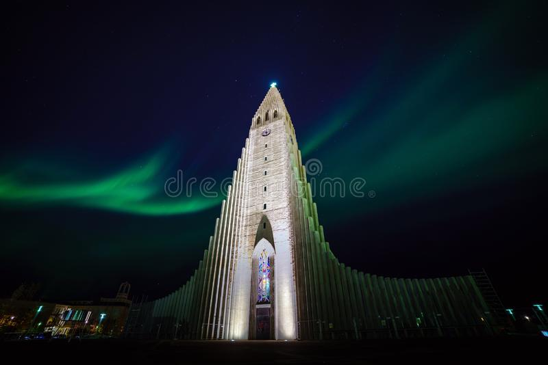 Northern lights shining over the church in Reykjavik royalty free stock images