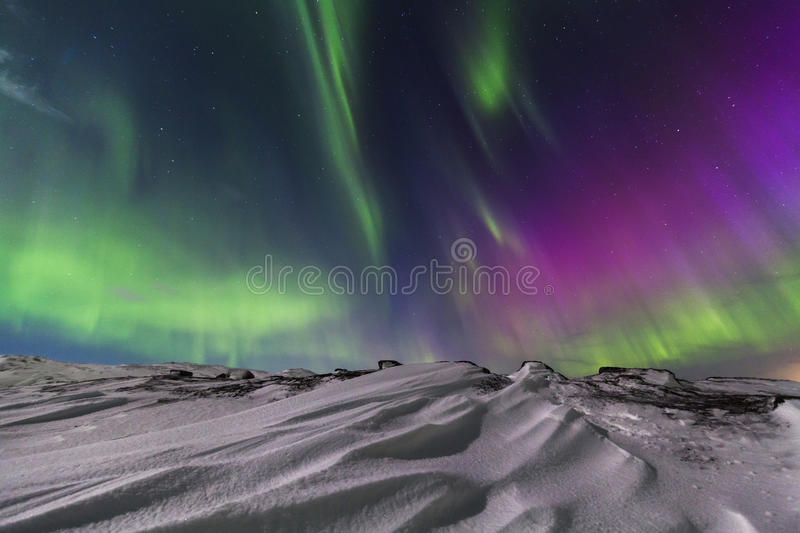 Northern Lights on the shore of the Arctic Ocean.  royalty free stock photography