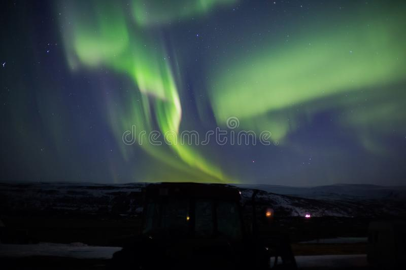 Northern lights with tractor stock photo