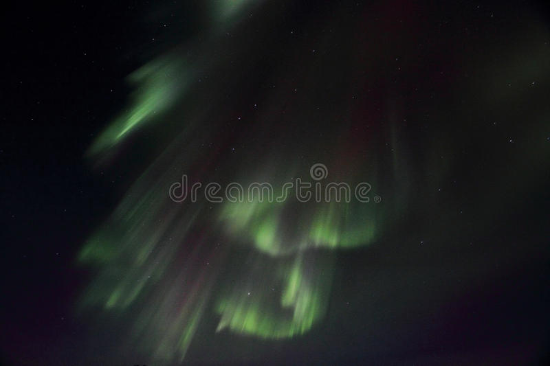 Northern Lights whith curtains shape. Northern Light over the fjord facing Gimsoey, Lofoten islands royalty free stock photos