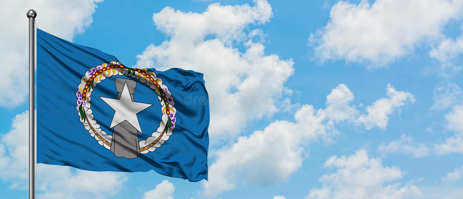 Northern Mariana Islands flag waving in the wind against white cloudy blue sky. Diplomacy concept, international relations.  royalty free stock images
