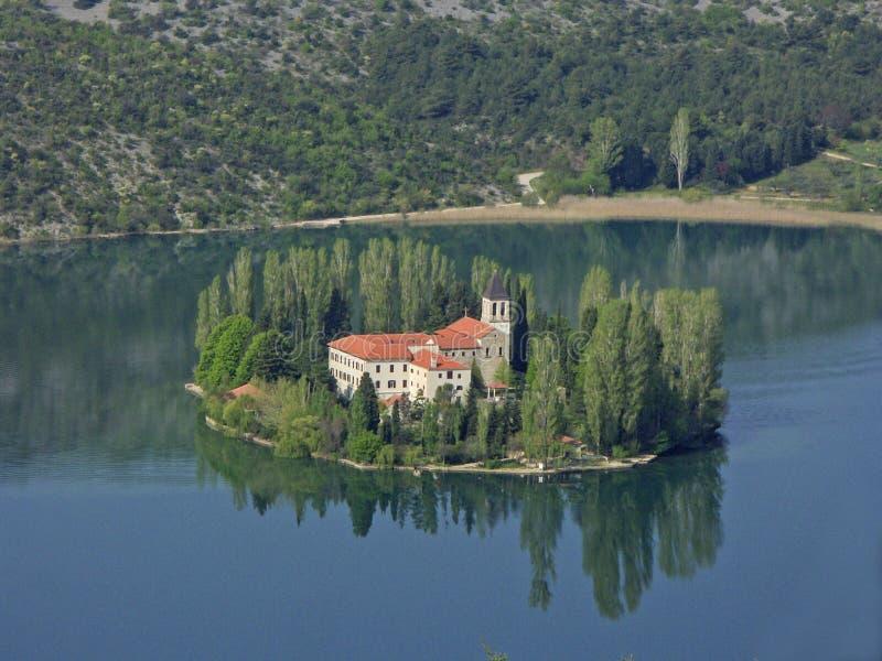 Monastery on an island in the lake Visovacko stock photos