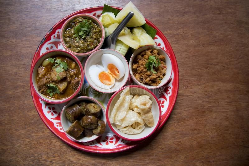 Northern Thai cuisine.Top view set of Thai northern food,  Pork curry, chili dip, minced pork salad, soft boiled vegetables and Th stock photos