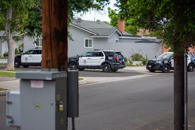Northridge, CA / United States -  May 27, 2019: LAPD Patrol Units respond to brandishing/ADW call in suburban neighborhood. With mulitple police cars.  Three stock photos