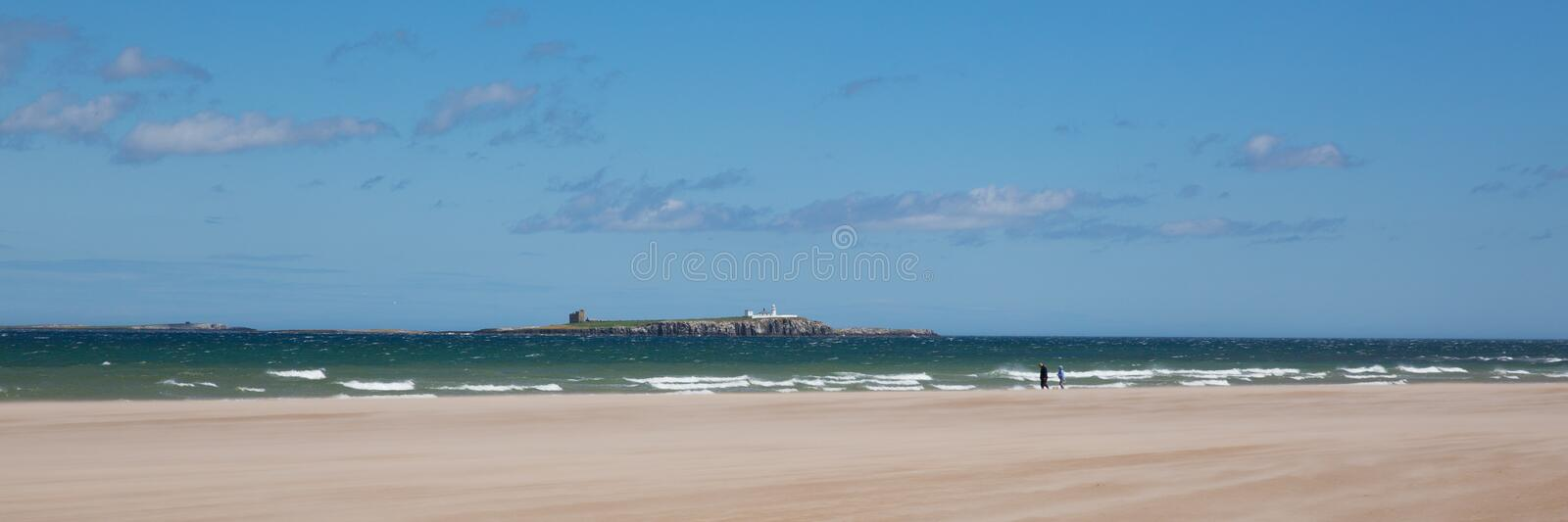 Northumberland white sandy beach and coast at Bamburgh north east England UK panoramic view. Northumberland beach and coast at Bamburgh north east England UK royalty free stock photography