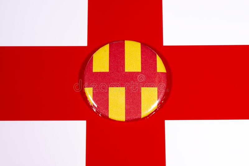 Northumberland in England. A badge portraying the flag of the English county of Northumberland, pictured over the England flag royalty free stock photos