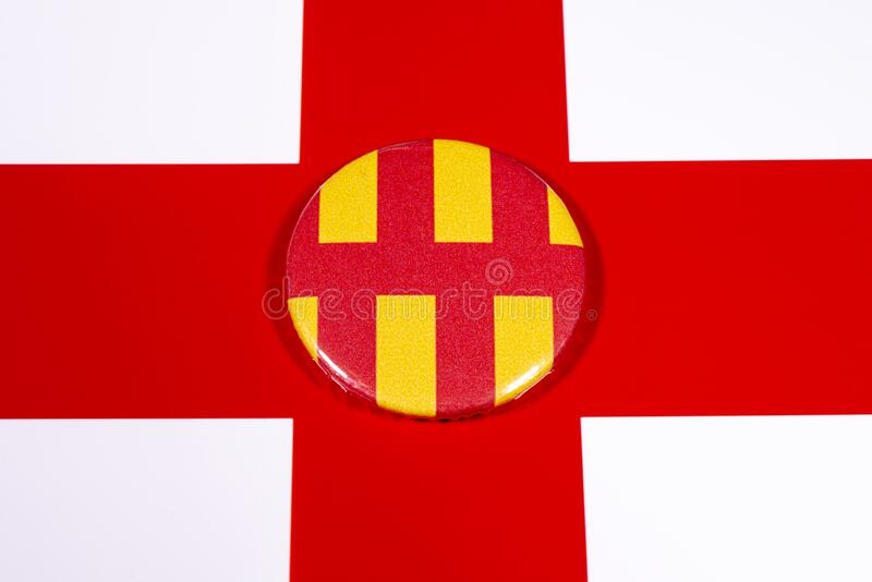 Northumberland in England. A badge portraying the flag of the English county of Northumberland, pictured over the England flag royalty free stock photography