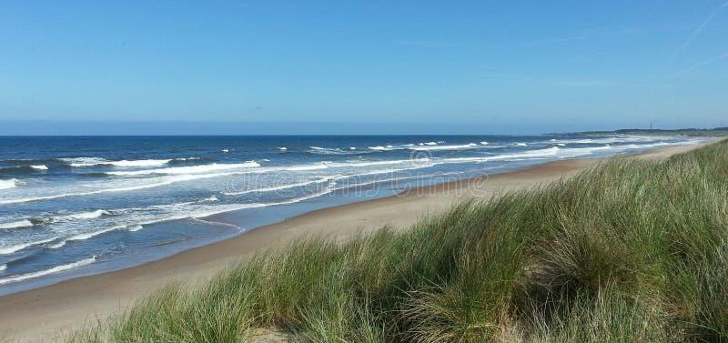 Northumberlands pittoreska stränder arkivbilder
