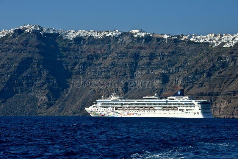 Norvegian line cruise ship anchored in front of Santorini stock photo