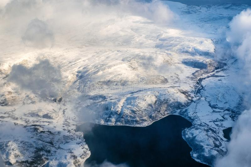 Aerial view of snowy landscape in winter with mountains and lakes in Norway stock photos