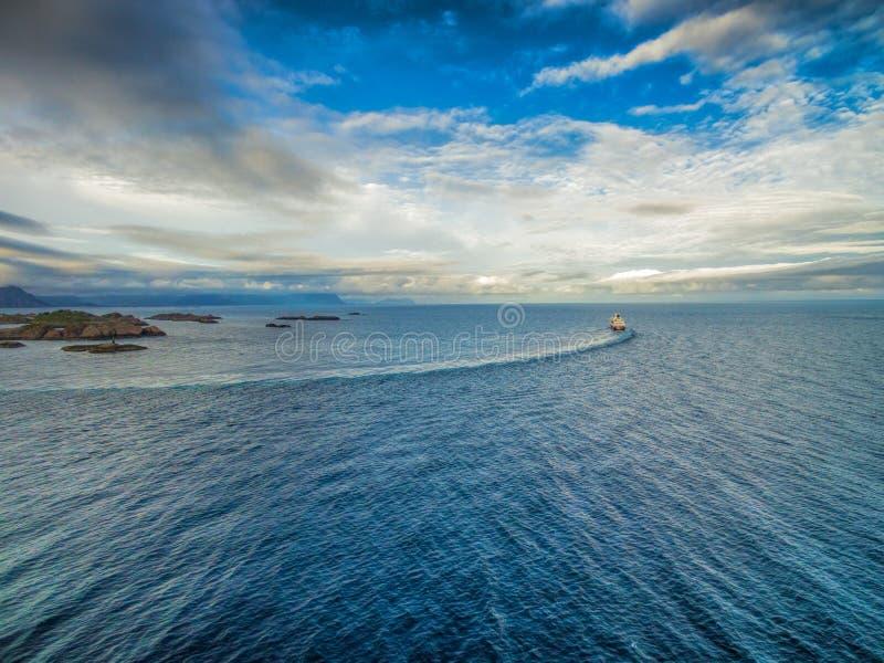 Norway coast with Hurtigruten. Aerial view of Hurtigruten leaving port on Lofoten islands royalty free stock image
