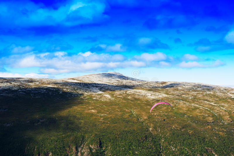 Norway daylight mountain with kite flyer landscape background. Hd royalty free stock photo