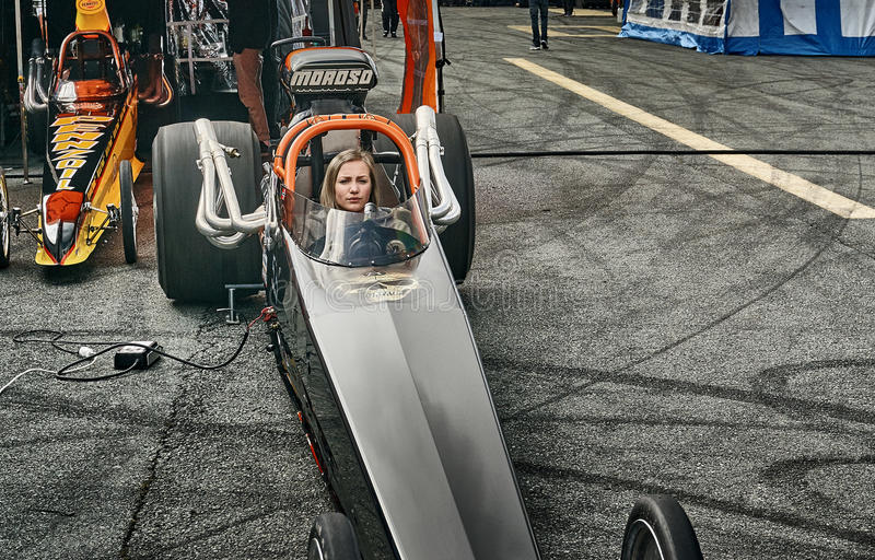 Norway drag racing, driver in a black race car front view stock image