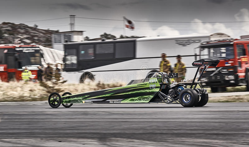 Norway drag racing, green racing car while driving royalty free stock images