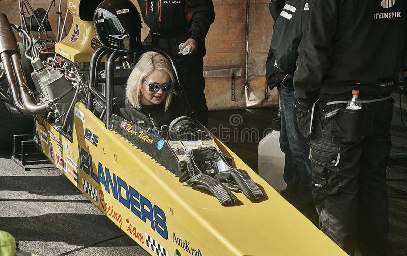 Norway drag racing, young female driver in the cockpit. royalty free stock photography