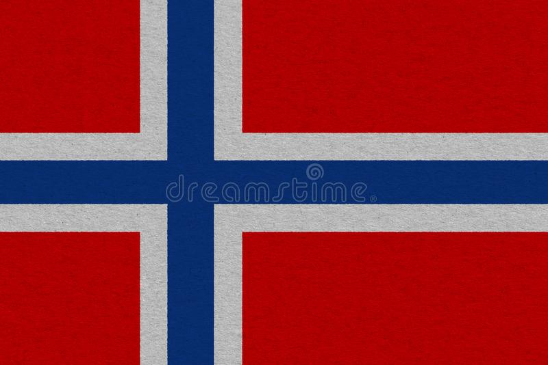 Norway flag painted on paper. Patriotic background. National flag of Norway royalty free stock image