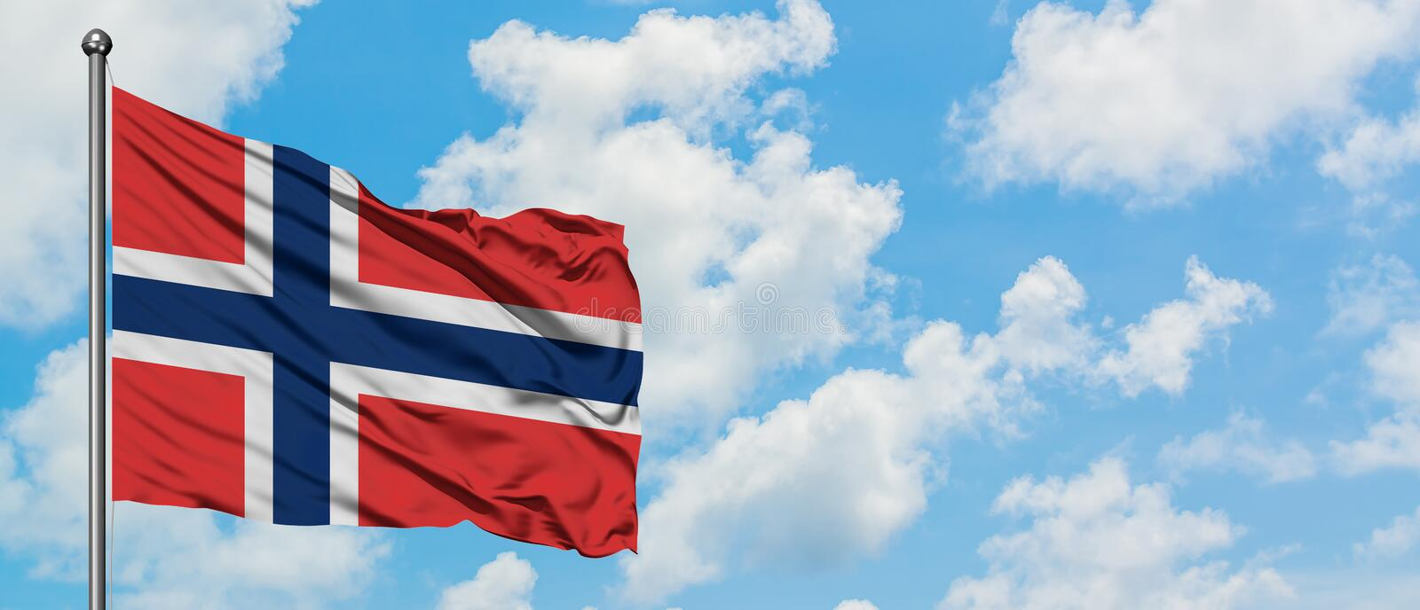Norway flag waving in the wind against white cloudy blue sky. Diplomacy concept, international relations.  royalty free stock photo