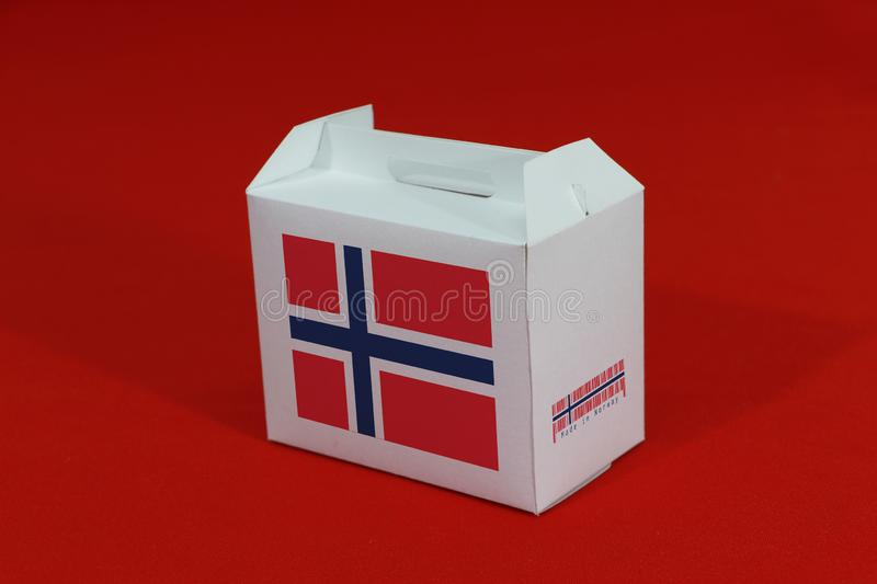 Norway flag on white box with barcode and the color of nation flag on red background. The concept of export trading from Norway. Paper packaging for put royalty free stock photos