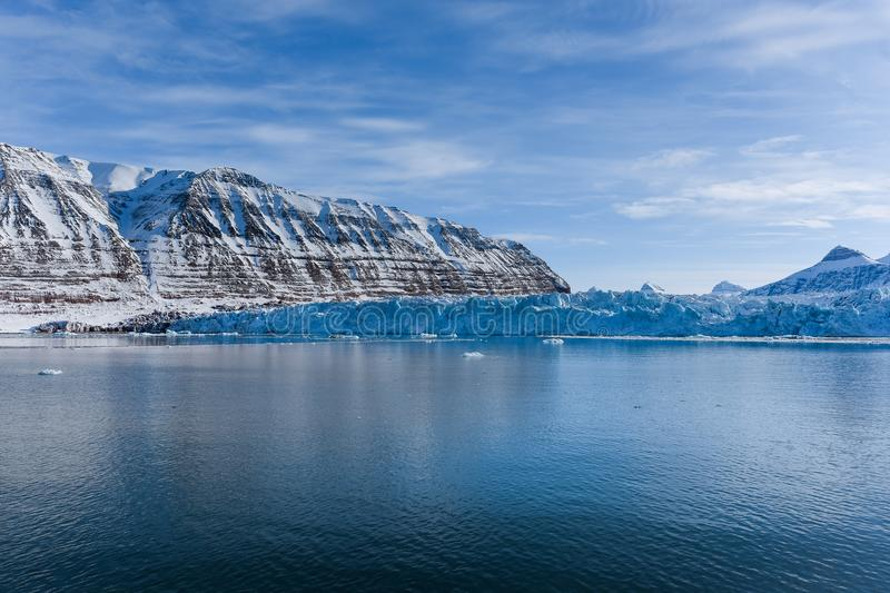 Landscape ice nature of the glacier mountains of Spitsbergen Longyearbyen Svalbard arctic ocean winter polar day sunset sky. Norway landscape ice nature of the royalty free stock photo