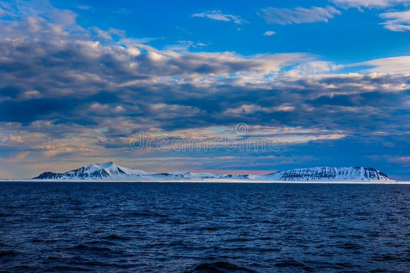 Norway landscape ice nature of the glacier mountains of Spitsbergen Longyearbyen Svalbard arctic ocean winter polar day sunset sky royalty free stock photos